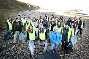 Litter pickers on the beach